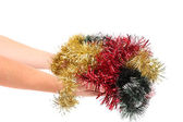Different color tinsel on hand. — Stock Photo
