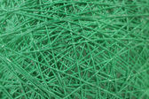 Background of randomly arranged fibers green. — Stock Photo