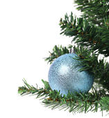 Blue ball on the Cristmas artificial fir. — Stock Photo