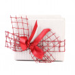 Stock Photo: White gift box with red ribbon and bow