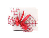 White gift box with red ribbon and bow — Stock Photo