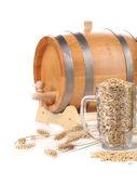 Barrel and a mug with barley. — Stock Photo
