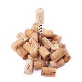 Corkscrew and wine corks — Stock Photo