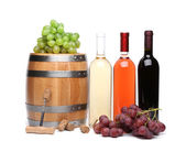 Barrel and bottles of wine — Stock Photo