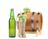 Barrel mug with hop and bottle of beer. — Stock Photo