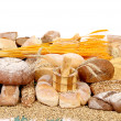 Composition of bread and golden ears. — Stock Photo