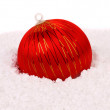 Stock Photo: Red christmas ball in snow.