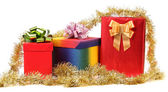 Set of gift boxes and gold tinsel. — Stock Photo