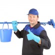 Man holding broom and bucket. — Stock Photo #33886453
