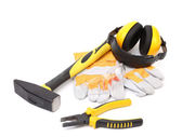 Protective ear muffs gloves and tools — Stock Photo