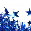 Closeup of christmas blue tinsel with stars. — Photo #34097397