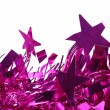 Closeup of christmas purple tinsel with stars. — Stock Photo