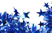 Closeup of christmas blue tinsel with stars. — Stock fotografie