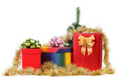 Gift boxes with christmas tinsel. — Stock Photo