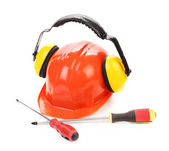 Hard hat ear muffs and screwdrivers. — Stock Photo