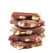 Tasty morsel of milk chocolate with nuts. — Stock Photo