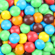 Chocolate drops with bright colored candy coating — Stock Photo