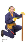 Worker in ear muffs with drill and board — Stockfoto