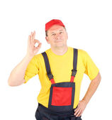 Worker shows hand sign okey — Stock Photo