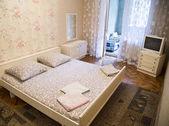 Close up of bedroom in beige colors. — Stockfoto