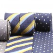 Rolled up three man's ties. — Stock Photo