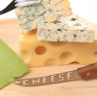 Various types of cheeses on wood — Stock Photo