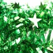 Stock Photo: Close up of christmas green tinsel with stars
