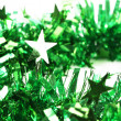 Close up of christmas green tinsel with stars — Stock Photo
