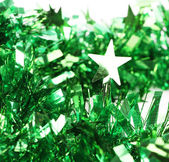 Close up of christmas green tinsel with stars — Stok fotoğraf