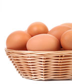 Eggs in the wicker basket — Stock Photo