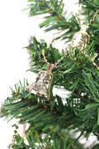 Christmas bell on green spruce branch — Stock Photo