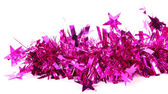 Close up of christmas purple tinsel with stars — Stock Photo