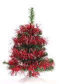 Christmas tree wrapped in tinsel — Stock Photo