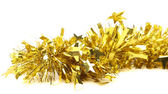 Close up of christmas yellow tinsel with stars — Stock Photo
