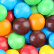 Backgroynd of chocolate balls in colorful glaze. — Stock Photo