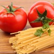 Spaghetti and tomatoes on board. — Stock Photo #35049207