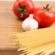 Spaghetti and tomatoes on board. — Stock Photo #35243011