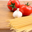Spaghetti and tomatoes on board. — Stock Photo