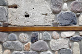 Wall of rocks and stones in cement. — Stock Photo