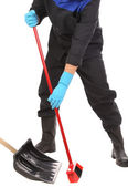 Worker sweeping floor. — Stock Photo