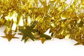 Close up of christmas yellow tinsel. — Stock Photo