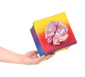 Hand holding gift in colorful package. — Stock Photo