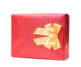 Red gift box with golden bow. — Stock Photo