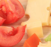 Close up of varoius cheese and tomatoes. — Stock Photo