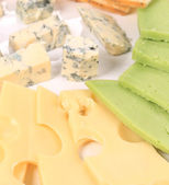 Various types of cheese on wooden platter. — Stock Photo