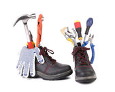Working boots with some different tools — Stock Photo