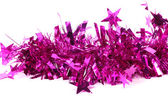Close up of christmas purple tinsel with stars. — Stock Photo