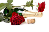 Red rose and a bottle of champagne. — Stock Photo