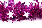 Christmas purple tinsel with stars. — Stock Photo