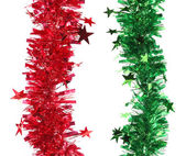 Christmas red and green tinsel with stars. — Stock Photo